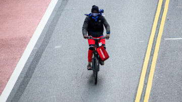 A Grubhub delivery person rides a bicycle on 42nd street during the coronavirus pandemic on May 18, 2020 in New York City.