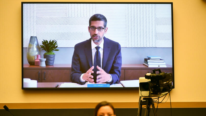 An image of Sundar Pichai on a screen during the House Judiciary Committee hearing on Antitrust Law