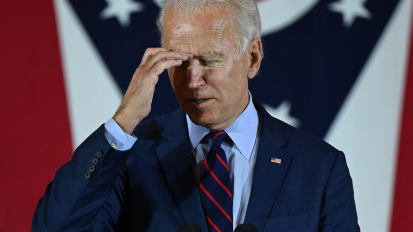 A photo of 2020 Presidential Candidate, Joe Biden, almost face palming