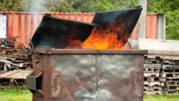 A photo of a dumpster on fire