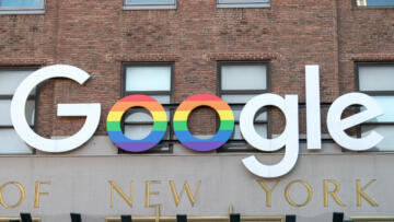 A photo of the Google logo on their New York building with some letters in the pride flag colors