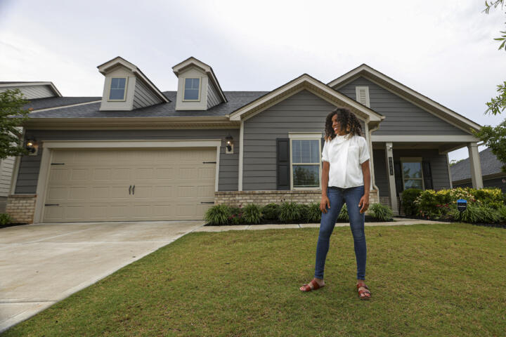 Crystal Marie McDaniels in the yard of her new Charlotte home.