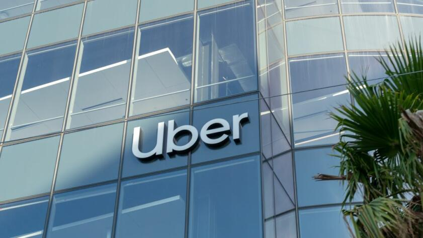 The Uber logo on glass facade of Uber headquarters